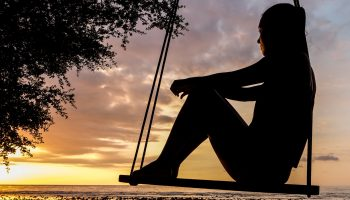 Fraser Watts Girl contemplating spirituality on swing